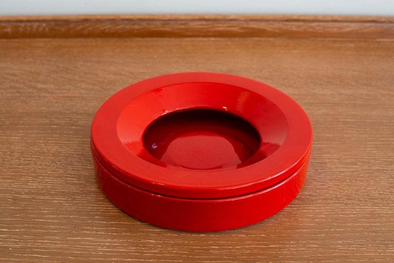 Great ceramic ashtray by Angelo Mangiarotti in a vibrant orange color. Perfect gift idea!