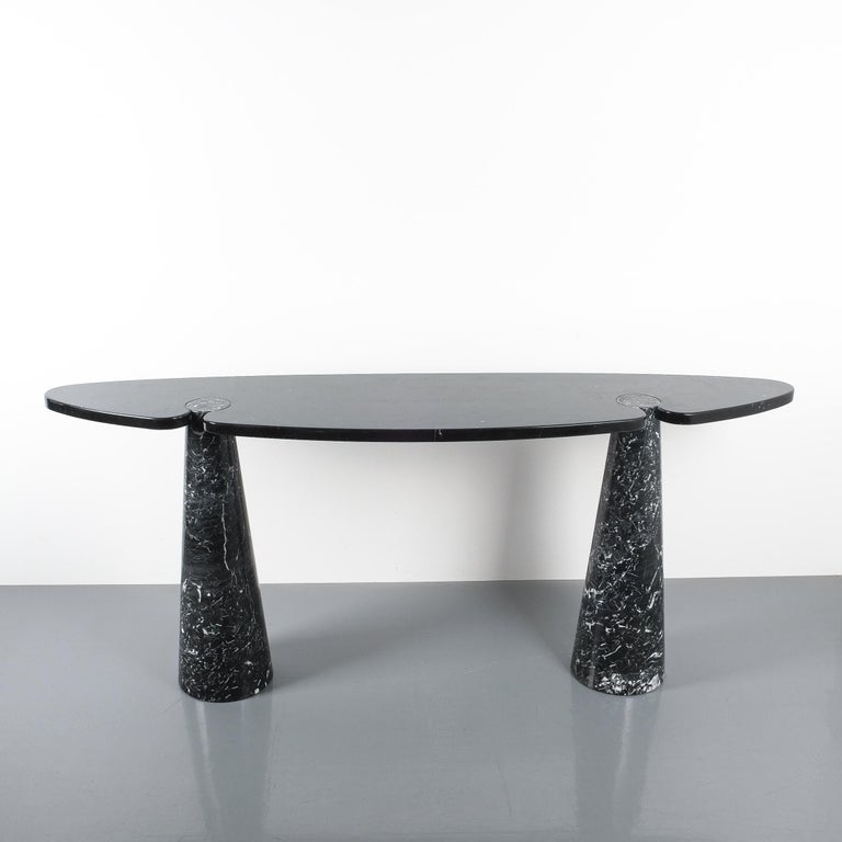 Angelo Mangiarotti console table Eros black marquina marble, Italy, circa 1975. Beautifully grained black and white solid marble piece with interlocking pedestals and tabletop. The table is in wonderful condition with hardly any wear. No chips or