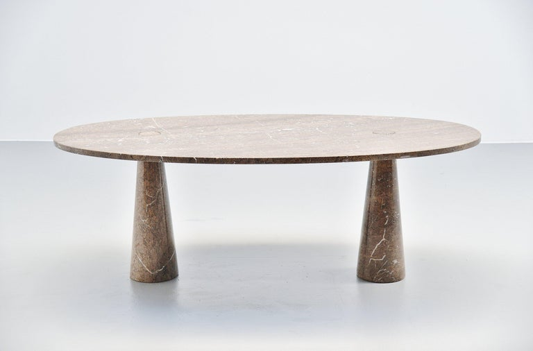 Spectacular oval 'Eros' dining table designed by Angelo Mangiarotti and manufactured by Skipper, Italy, 1971. This oval dining table is made of brown mondragone marble and has beautiful grey and white white veins in the brown beige marble. This