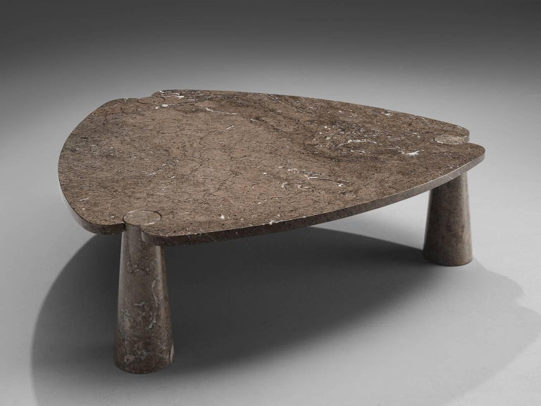 Angelo Mangiarotti, coffee table, marble, 1970s.   This sculptural side table by Angelo Mangiarotti is a skillful example of postmodern design. The table is executed in grey marble featuring delicate white veins. The soft edged triangle table