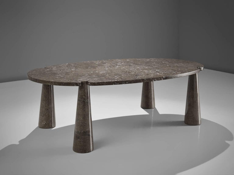 Angelo Mangiarotti, dining table, marble, 1970s.   This sculptural table by Angelo Mangiarotti is a skillful example of postmodern design. The table is executed in grey marble. The oval table features no joints or clamps and is architectural in