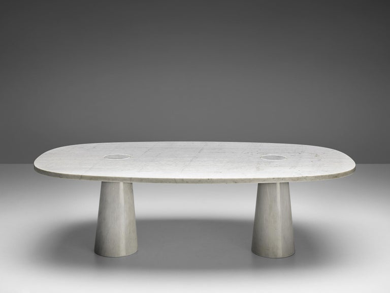 Angelo Mangiarotti, dining table, marble, 1970s.  This sculptural table by Angelo Mangiarotti is a skillful example of postmodern design. The table is executed in white marble. The oval table features no joints or clamps and is architectural in its