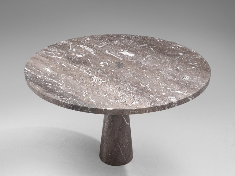 Angelo Mangiarotti, dining table, marble, 1970s.  This sculptural table by Angelo Mangiarotti is a skilful example of postmodern design. The table is executed in grey marble featuring delicate white veins. The soft edged circular table features no