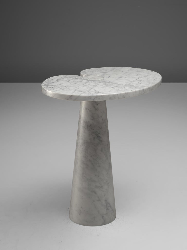 Angelo Mangiarotti, cocktail table in white marble, Italy, 1970s.   This sculptural table by Angelo Mangiarotti is a skillful example of postmodern design. The lotus leaf like side table features no joints or clamps and is architectural in its