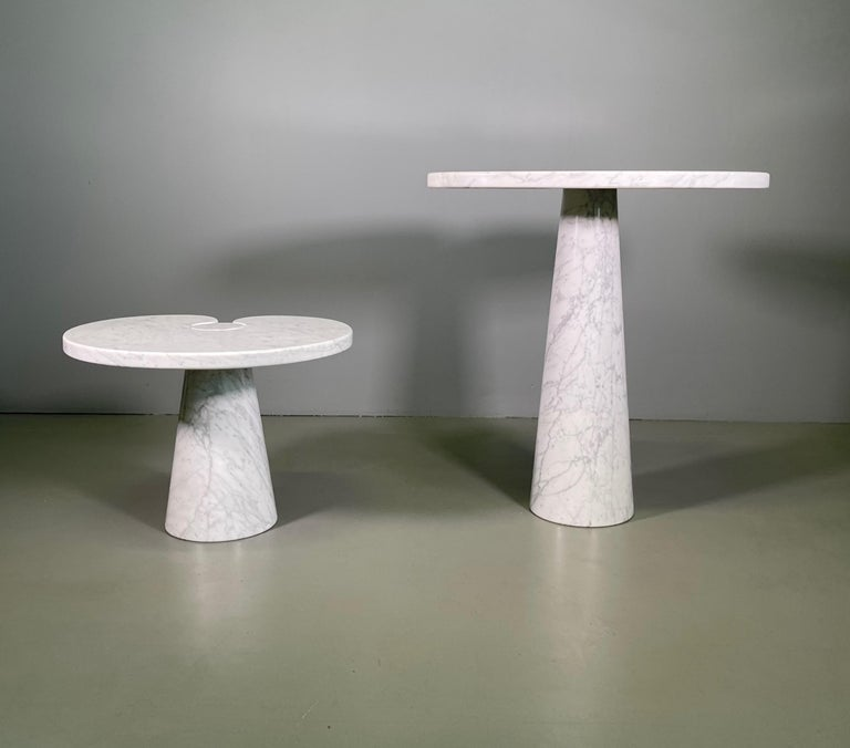 Designed by Angelo Mangiarotti for Skipper from the 'Eros' series, Carrara marble side table with top fitted on conical bases, Italy, 1971. Original Skipper label. Measures: The big H 72 cm x W 66 cm x D 45 cm The little H 40 cm x W 55 cm x D 46