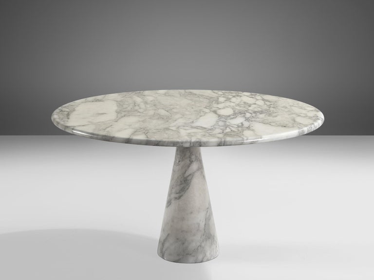 Angelo Mangiarotti for Skipper, 'M1' dining table, marble, Italy, 1969  Angelo Mangiarotti designd the 'M1' dining table for Skipper in 1969. On a cone shaped pedestal rests the round tabletop. The white marble shows a dynamic grain and so the