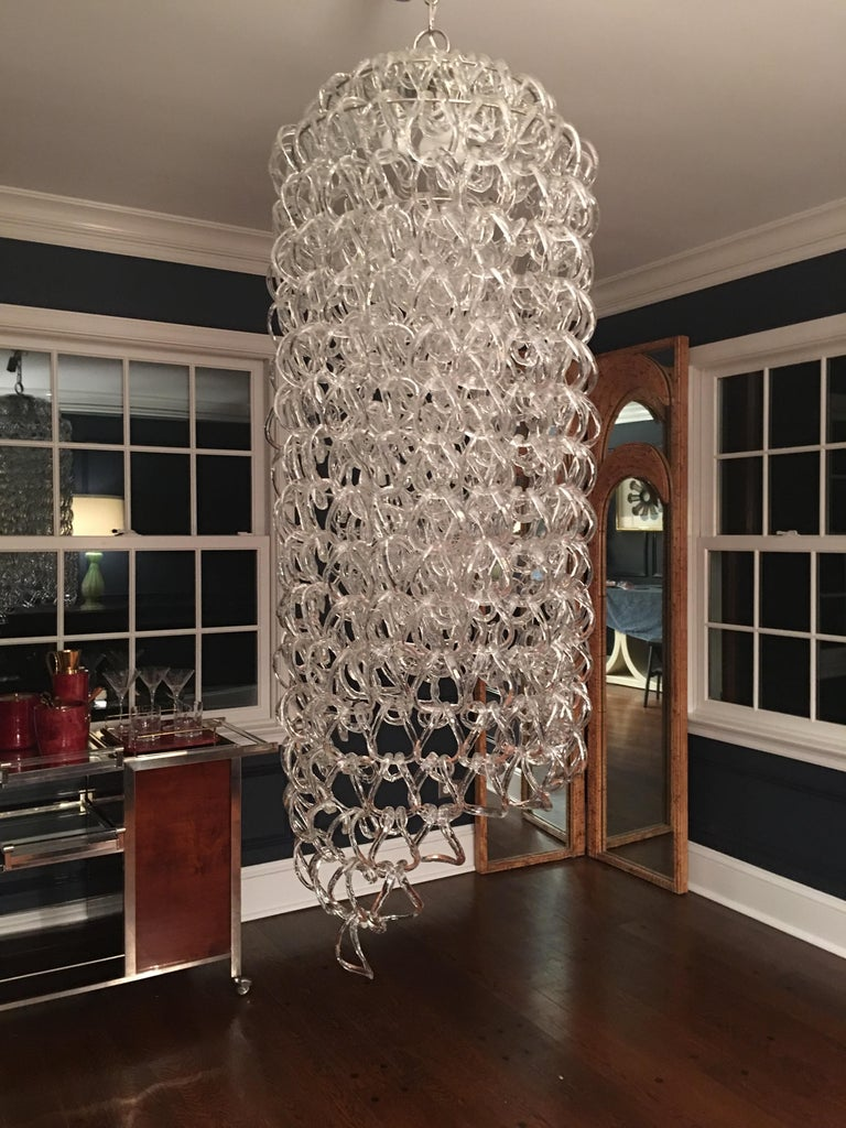 Original large Angelo Mangiarotti for Vistosi 'Giogali' chandelier circa 1970 made with over 400 Murano handmade glass links in double horseshoe rings, suspended by tiered metal frame, Italy, c. 1970.  Truly elegant design of cascading links that