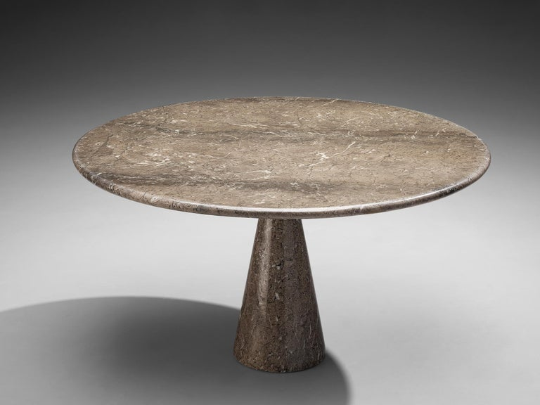 Angelo Mangiarotti for Skipper, 'M1' dining table, marble, Italy, 1969.  Angelo Mangiarotti designed the 'M1' dining table for Skipper in 1969. On a cone shaped pedestal rests the round tabletop. The brown marble shows a dynamic grain and so the