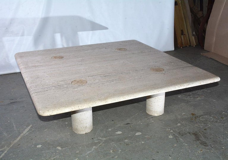A rare travertine 1970s coffee table designed by Angelo Mangiarotti for Up&up Italy. Angelo Mangiarotti made much use of marble and travertine in his designs. His work is a very clear example of Italian design. The column shaped legs are interlocked