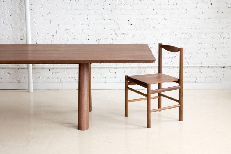 Contemporary Angled Leg Column Dining Table in Walnut by Fort Standard, in Stock In New Condition For Sale In Brooklyn, NY