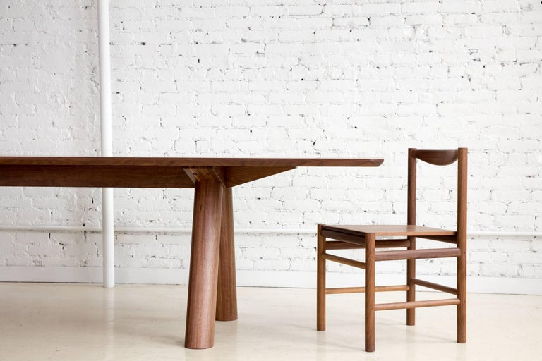 Contemporary Angled Leg Column Dining Table in Walnut by Fort Standard, in Stock For Sale 1