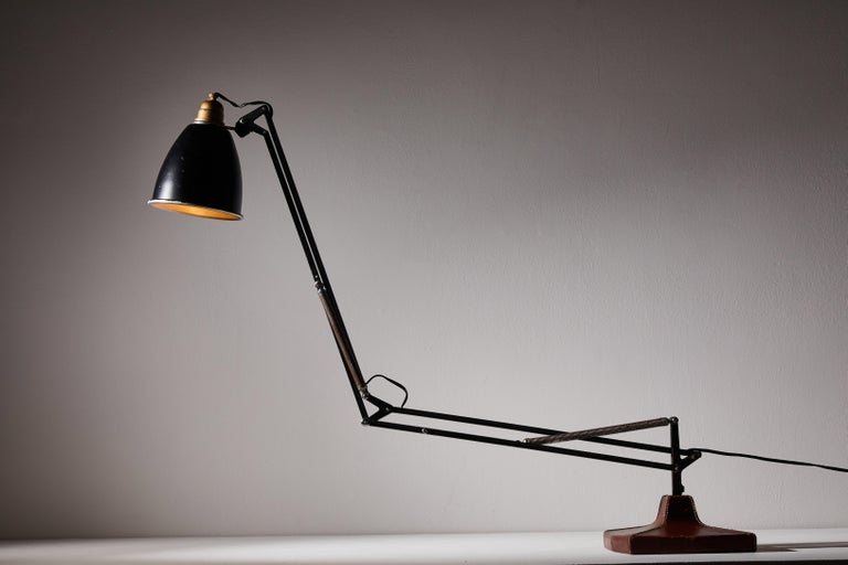 Anglepoise table lamp by George Cawardine & Hermes for Herbert Terry & Sons Ltd. Designed and manufactured in United Kingdom, circa 1930s. Leather over steel, enameled aluminum, enameled brass. Original cord. Signed with impressed gilt