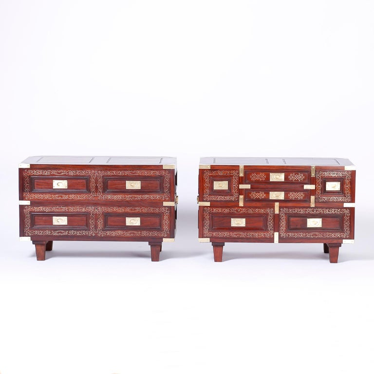 Anglo Indian pair of nightstands with the unusual duel option of stacking into a chest of drawers. Featuring rosewood construction, inlaid brass floral designs, panels sides, and tapered legs.  Measures: Nightstands H 19, W 30, D 15 Chest H 34, W