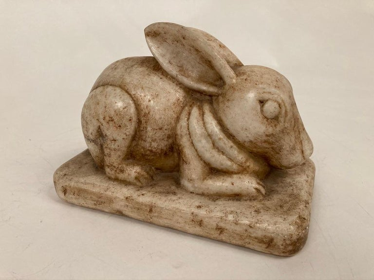 Charming Anglo-Indian hand carved marble rabbit. A wonderful piece of animal sculpture that will bring some joy into your space. Great gift idea for the animal lover in your life. Also will make a great door-stop.
