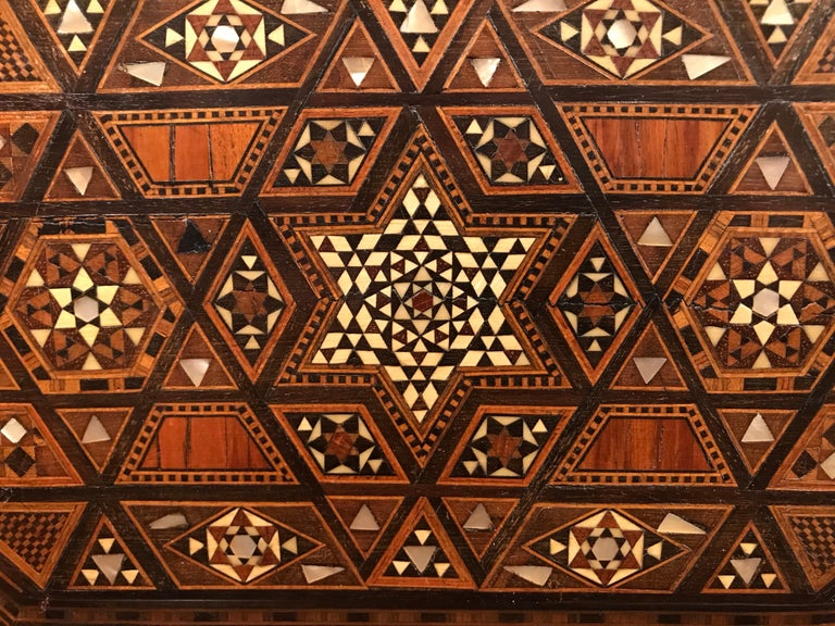 A beautifully designed Moroccan box with the surface completely inlaid with tropical woods, such as rosewood and ebony, polished bone and mother of pearl. I'm always astounded by the intricate workmanship of these boxes. The interior of the lid is