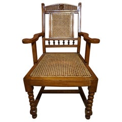 Anglo-Indian Teak Rosewood Cane Armchair With Barley Twist Legs