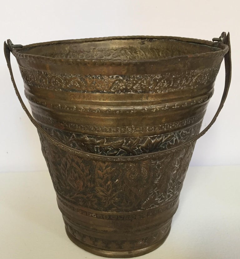 19th century Anglo Raj Mughal bronzed metal copper vessel water or milk bucket. Originally used to carry water, this hand-hammered metal vessel from India has authentic texture, wonderful patina, and great form and character. Great patina on