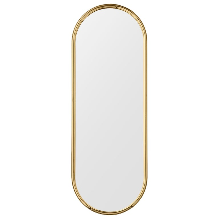 Angui golden oval large mirror by AYTM Dimensions: 39 x 2 x 108 cm Materials: Glass, copper, MDF  The Angui mirror with its simple pipe-styled frame is a beauty for any bathroom, hallway, or maybe bedroom. Use a single one or add several