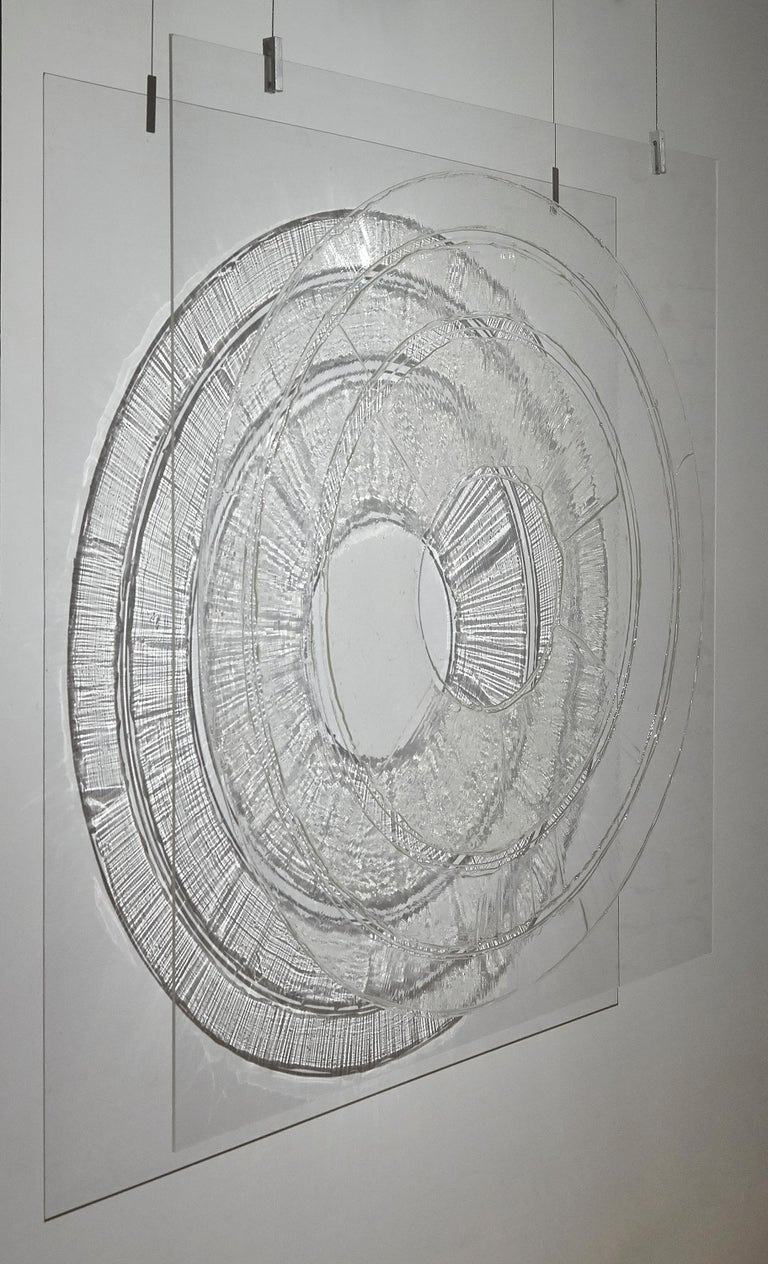 Shadows cast by light shone through a translucent and loosely concentric gel pattern on clear plexiglass create an elegant non-material extension of the image. The painting by Ania Machudera is wall mounted and hangs about four inches from the wall.