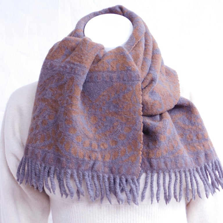 Woven carmel and grey Italian wool scarf by Anichini. ANICHINI, Inc. is an American luxury textiles company based in Tunbridge, Vermont. The company is a manufacturer and importer of luxury linens and textiles .