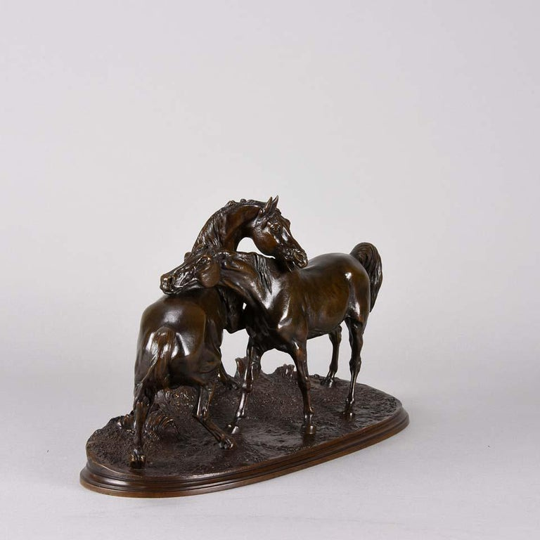 """A wonderful mid-19th century animalier bronze cast from the artist's own workshop, this is a rare bronze study of an Arab Stallion and Mare. Originally entitled """"Tachiani et Nedjibe, Arab horses"""" the composition captures the individual"""