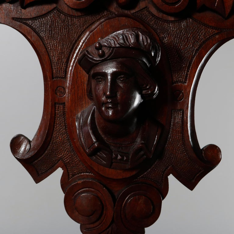 An antique figural Victorian Jelliffe school architectural pediment offers carved walnut in shield form with palmette and foliate scroll crest surmounting central male portrait mask, circa 1870.  ***DELIVERY NOTICE – Due to COVID-19 we are employing