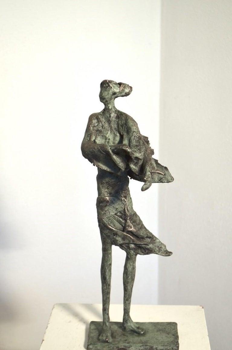 Anke Birnie Figurative Sculpture - In de wind - contemporary standing female figure wind unique bronze sculpture