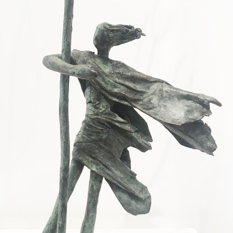 Hold Tight - contemporary figurative standing female bronze sculpture tree windy - Sculpture by Anke Birnie