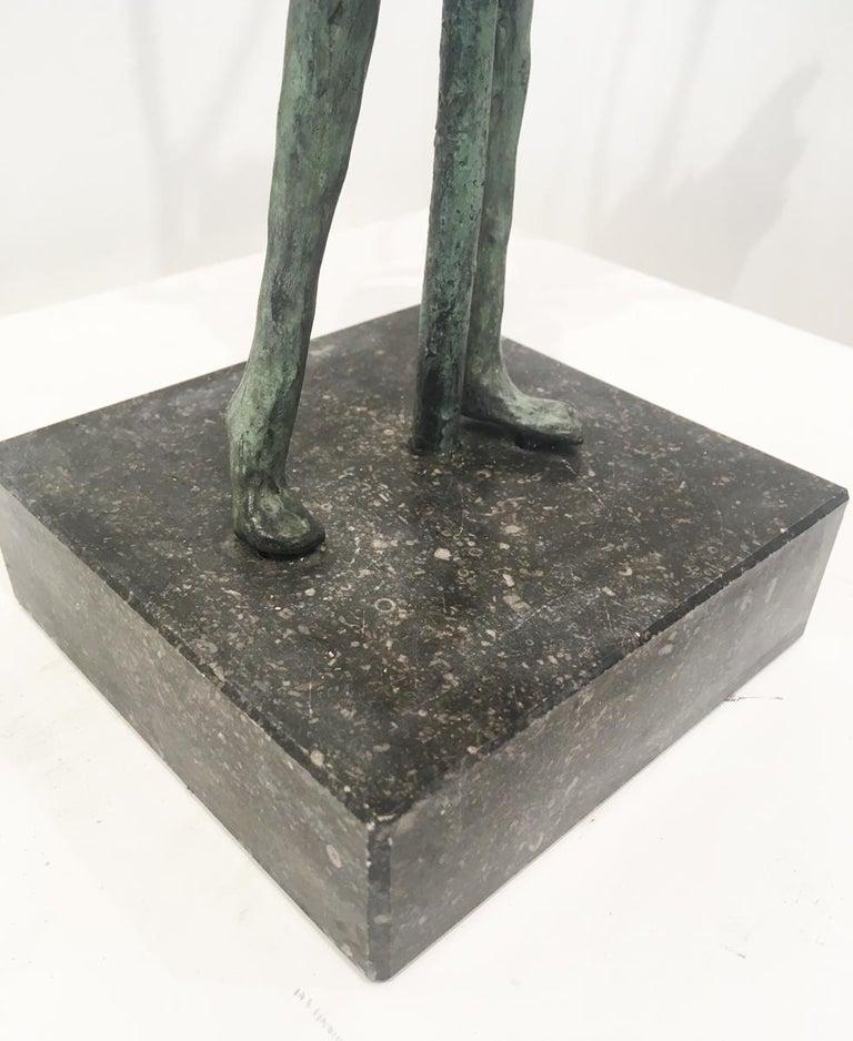Hold Tight - contemporary figurative standing female bronze sculpture tree windy - Gold Figurative Sculpture by Anke Birnie