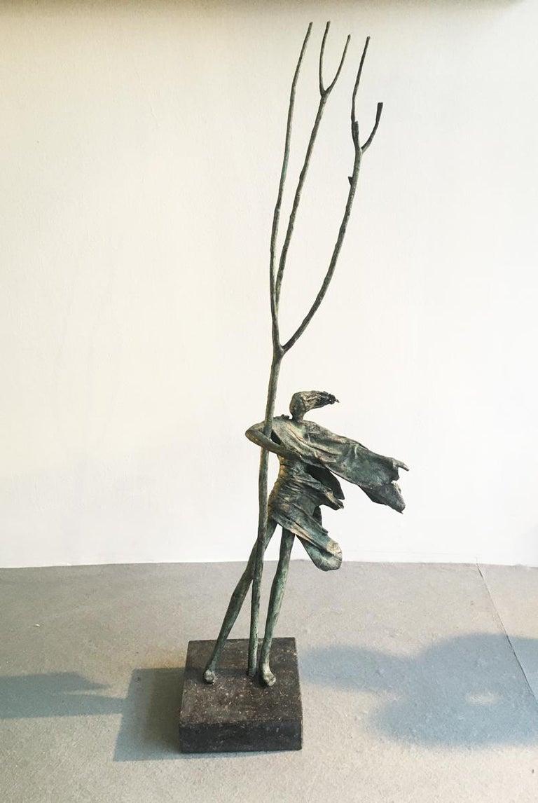 Anke Birnie Figurative Sculpture - Hold Tight - contemporary figurative standing female bronze sculpture tree windy