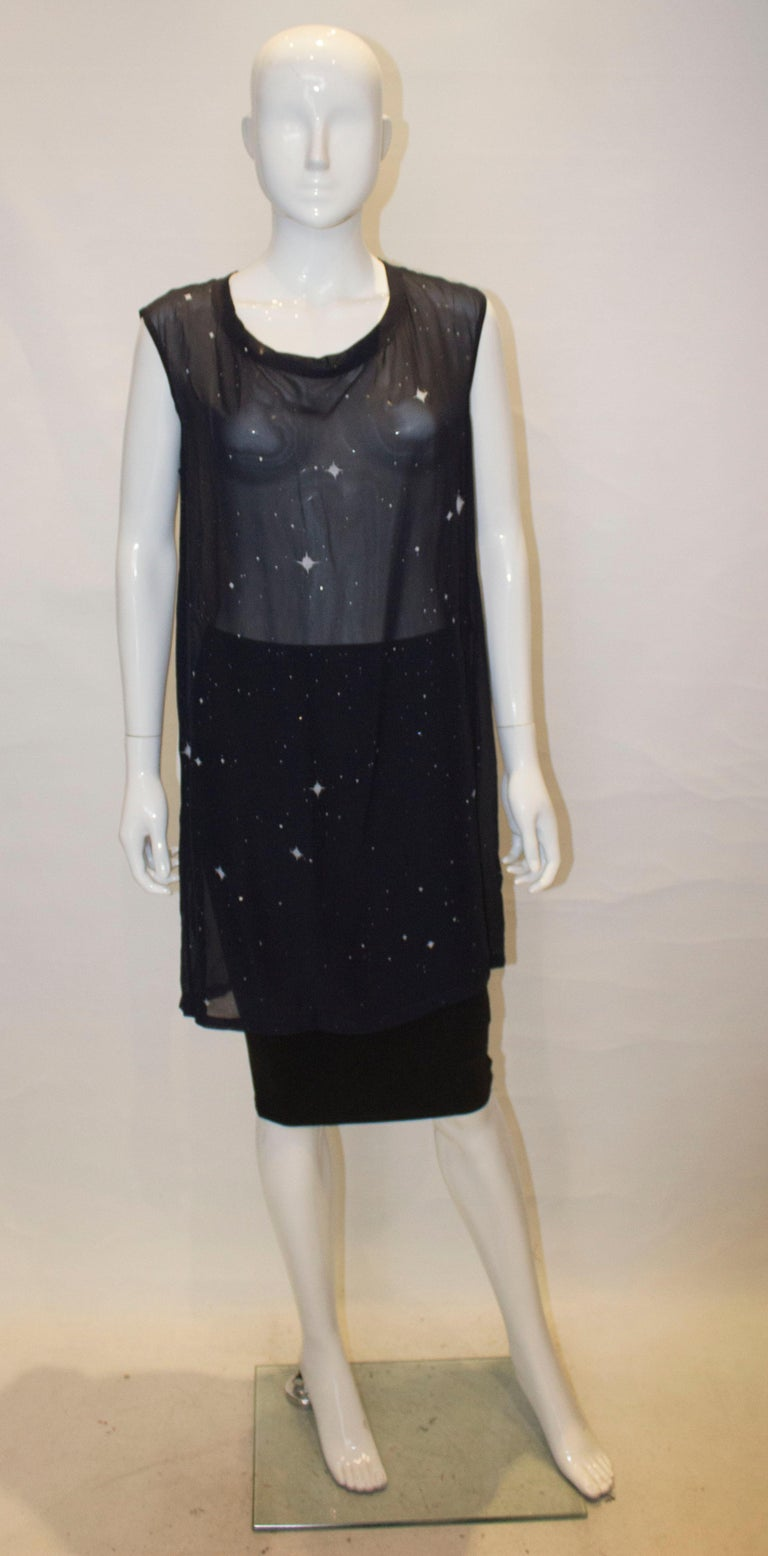 An attractive silk top by Ann Demeukemeester. In a blue silk , the top has decoration on the front and has a round neckline.