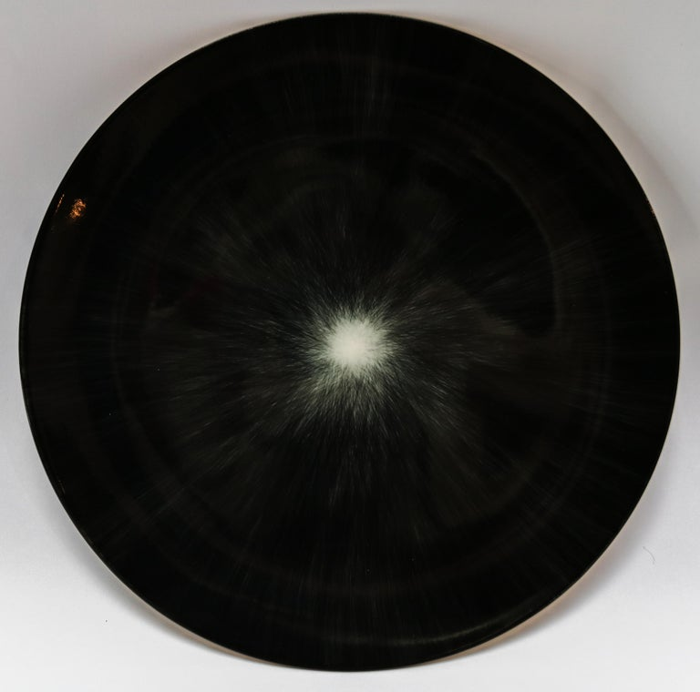 Ann Demeulemeester for Serax Dé dinner plate / charger in black / off white. Hand painted with a starburst pattern.  28cm diameter x 1.8 cm high. Must be purchased in quantities of two.