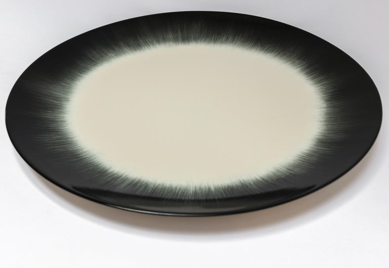 Ann Demeulemeester for Serax Dé dinner plate / charger in off white / Black. Hand painted with a starburst pattern. 28cm diameter x 1.8 cm high. Must be purchased in quantities of two.