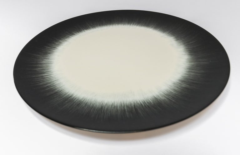 Ann Demeulemeester for Serax Dé dinner plate in off white / black. Hand painted with a starburst pattern. Measures: 24cm diameter x 1.1 cm high. Must be purchased in quantities of two.