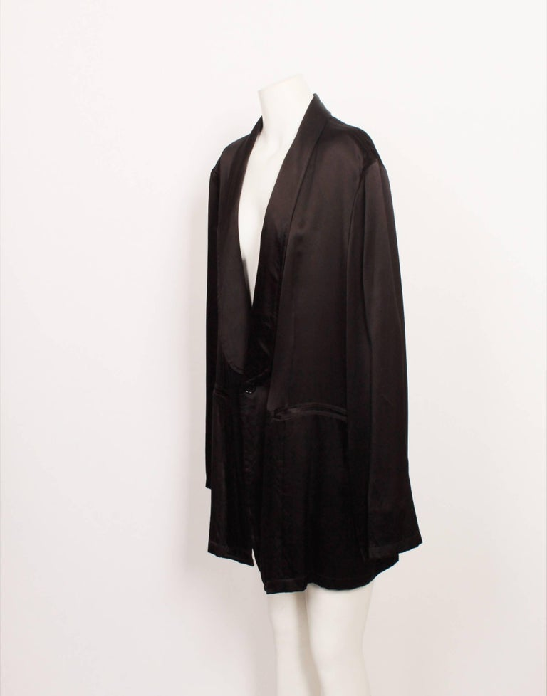 Ann Demeulemeester incorporates somber, moody hues throughout collections. Reflecting the label's artistic sensibility, slick-cut asymmetric accents include pieces with offbeat embellishments  Blazer Material: 100% silk Country: Belgium Size:
