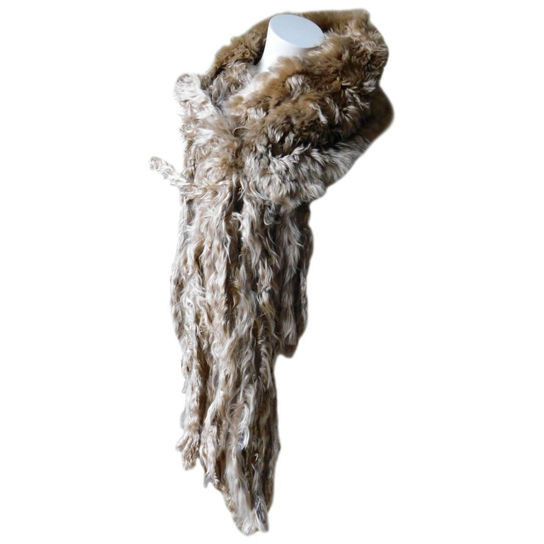 Luxurious unisex llama fur wrap shawl by the edgy Belgian designer  Ann Demeulemeester. Very silky soft and luminous in very good condition, the skin is double folded so there is no inside or outside. The long fur fringe makes it possible to tie in