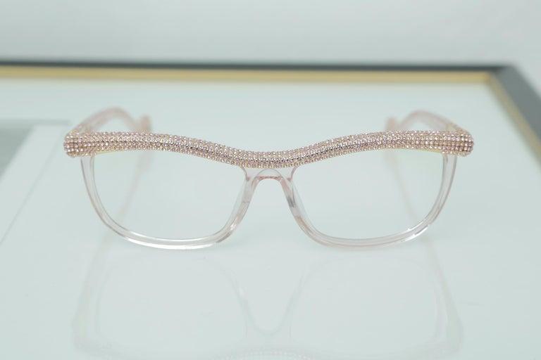 Anna-Karin Karlsson Pink Kiki On A String Glasses Sunglasses These Kiki on a String glasses feature pink Swarovski crystals and 14 K gold.  Simply stunning
