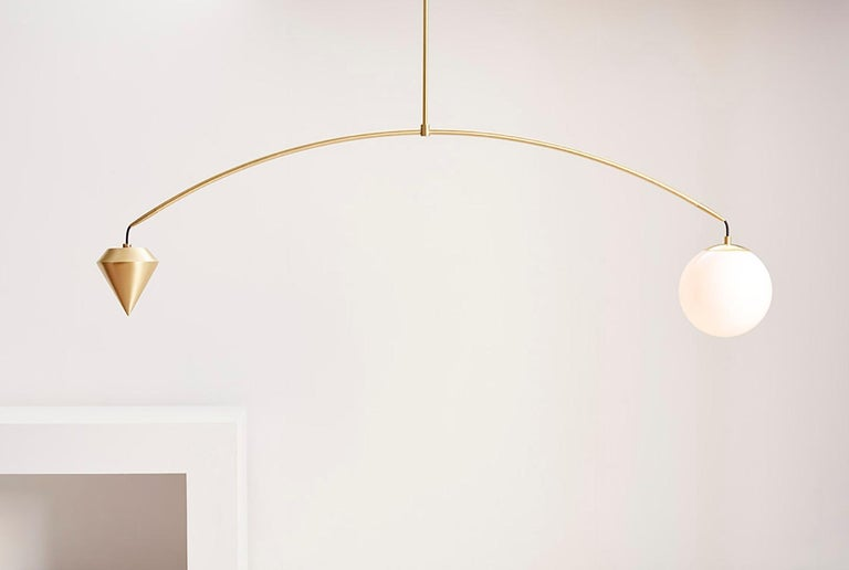 A beautifully tapered stem balances a perfect white glass orb with our brass plumb weight.  Available in brushed brass and satin black (a rich warm black).  Custom sizes can be accommodated please contact us for more details.  Requires type a