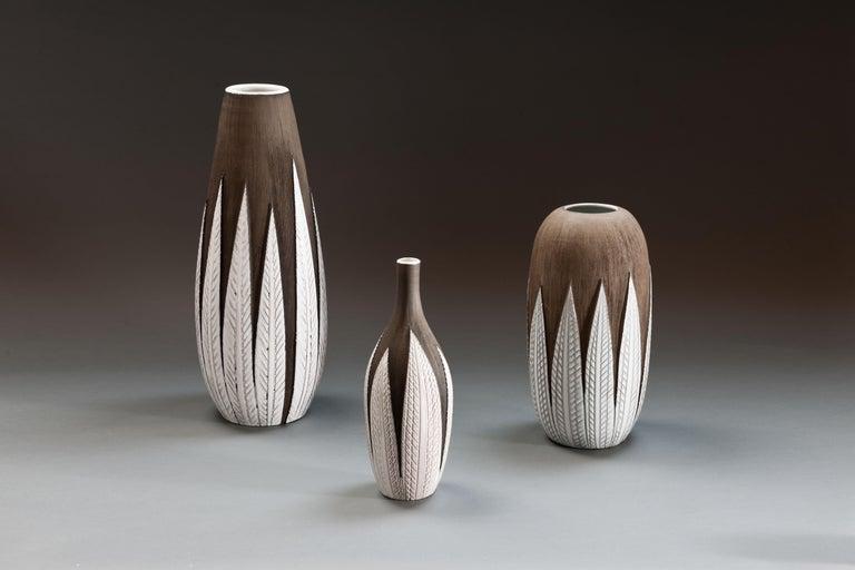 Set of 3 large vintage ceramic 'Paprika' vases by Swedish designer Anna-Lisa Thomson. Unglazed dark brown textured ceramic covered with contrasting glazed leaves.  Thomson designed the 'Paprika series' in 1948-51 for the ceramics company Upsala