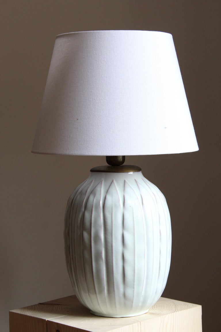 A large and early modernist table lamp. Designed by Anna-Lisa Thomson, for Upsala-Ekeby, Sweden, 1940s. With stamp including artist's initials.  Sold without lampshade. Stated dimensions exclude the lampshade.  Other designers of the period