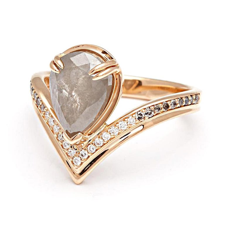 2.50 ctw milky grey diamond pear center with white and grey diamond pave set in 14k recycled yellow gold.  A dynamic band of V-shaped yellow gold is inlaid with luminous grey and white diamonds, holding aloft a stunning milky grey diamond pear at