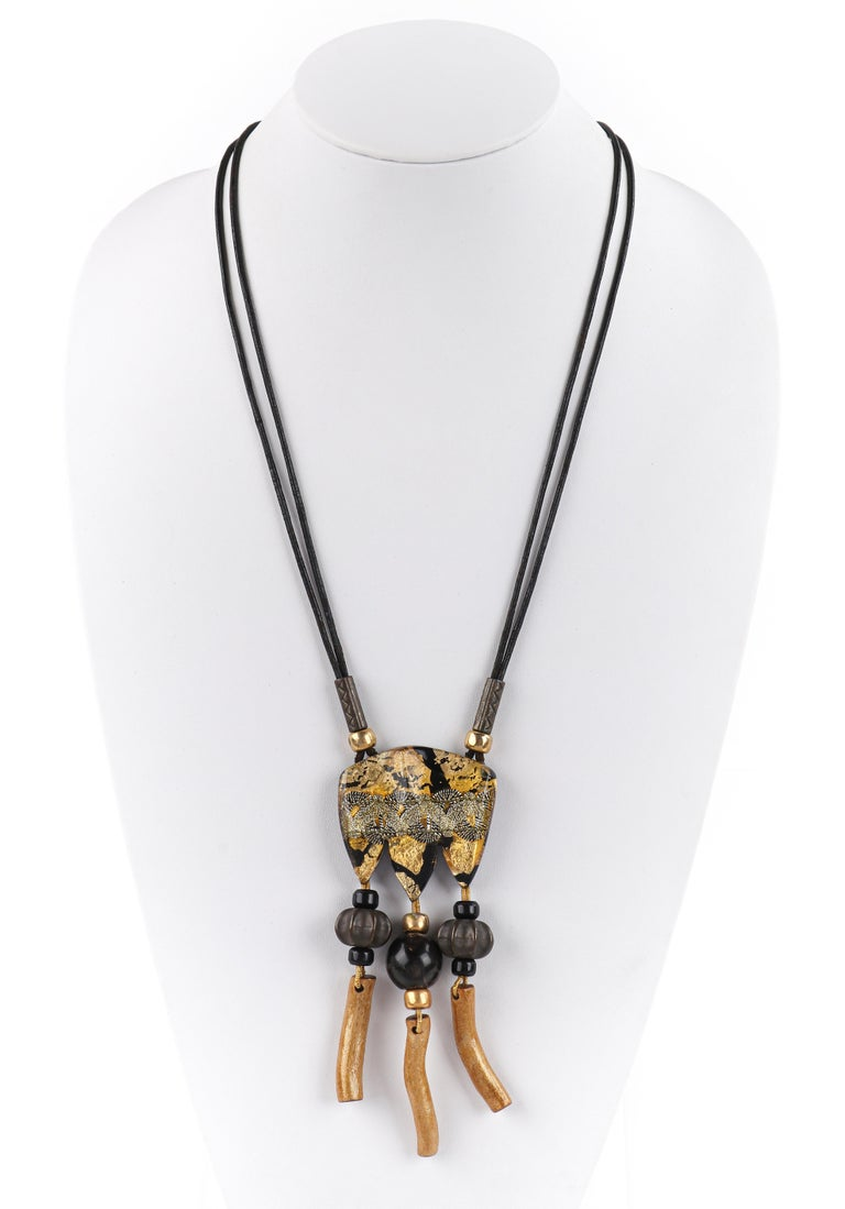 ANNE & FRANK VIGNERI Black Gold Metallic Beaded Lucite Art Pendant Cord Necklace   Brand / Manufacturer: Vigneri Circa: 1980s-1990s Style: Pendant necklace Color(s): Shades of black, gold, brown, silver Unmarked Material (feel of): Pendant: Lucite;