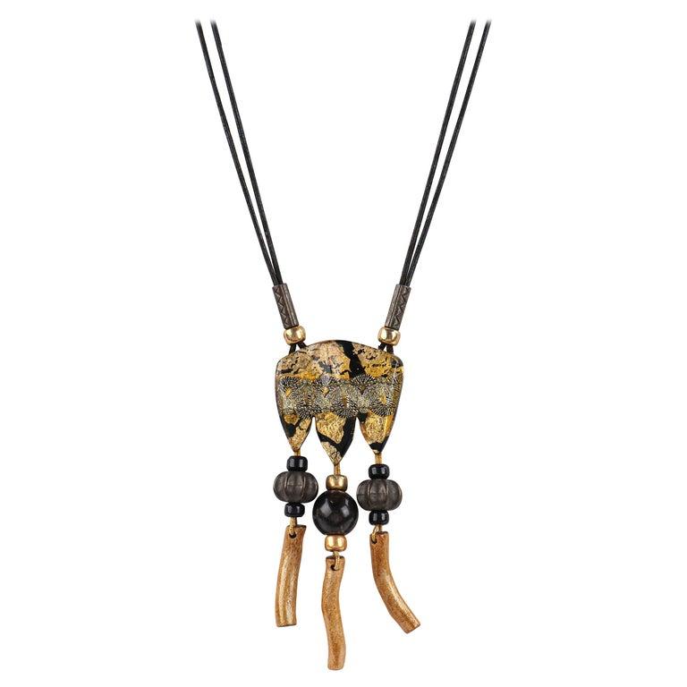 ANNE & FRANK VIGNERI Black Gold Metallic Beaded Lucite Art Pendant Cord Necklace For Sale