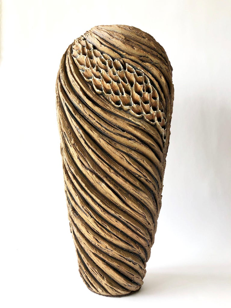 Large scale, carved ceramic sculptural form created by Anne Goldman of California. Sculpture is without bottom and is therefore hollow on the bottom. Piece measures 24