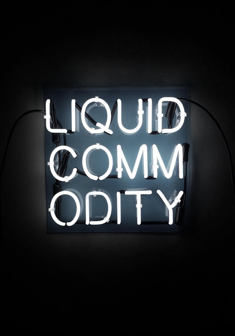 'Liquid Commodity' Text-based White Neon Sign Light Lighting Art Sculpture Words - Black Figurative Sculpture by Anne-Katrine Senstad