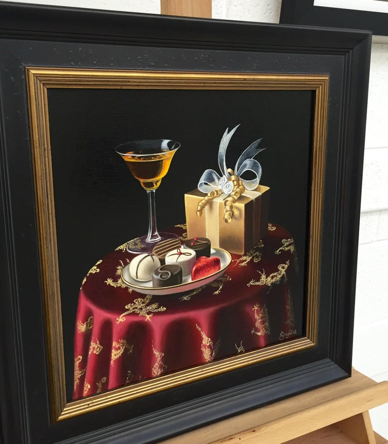 Realist Still Life Painting of Chocolates with Orange Liqueur by British Artist - Black Interior Painting by Anne Songhurst