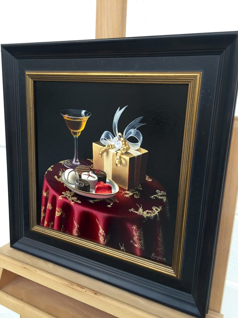 Realist Still Life Painting of Chocolates with Orange Liqueur by British Artist, Anne Songhurst. Contemporary oil paintings inspired by the Dutch Masters. Born in Kent in 1946, Anne developed her passion for painting as a child. She is one of the