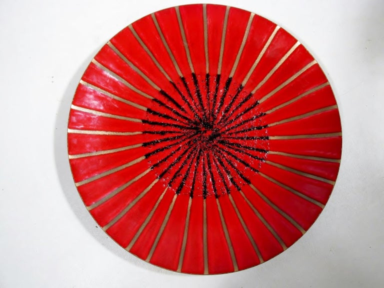 """Unusual 11.75"""" diameter round modernist enamel on copper charger with an abstract starburst decoration by renowned California artisan Annemarie Davidson.   Condition is excellent overall showing light use scuffing and no chips, cracks, repairs, or"""