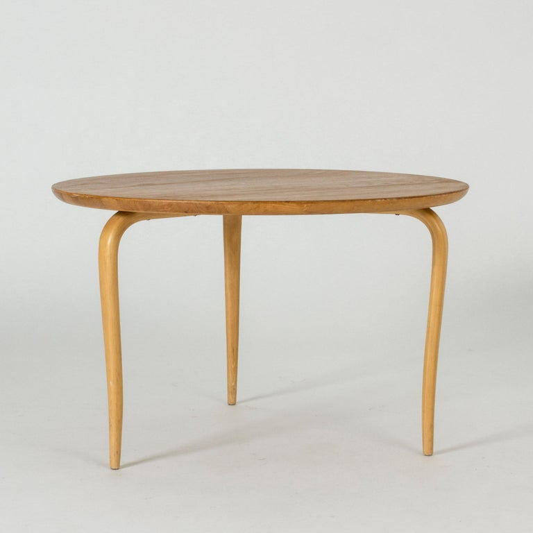 "Beautiful ""Annika"" side or small coffee table by Bruno Mathsson. Round oak table top, slender legs made from beech."