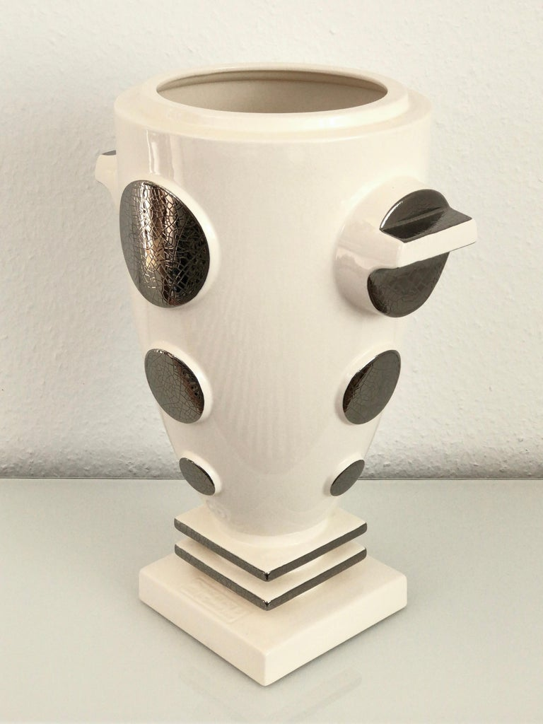 Emaux de Longwy ceramic vase decorated with real platinum (craquelling).  White craquelling glazed.  Model: